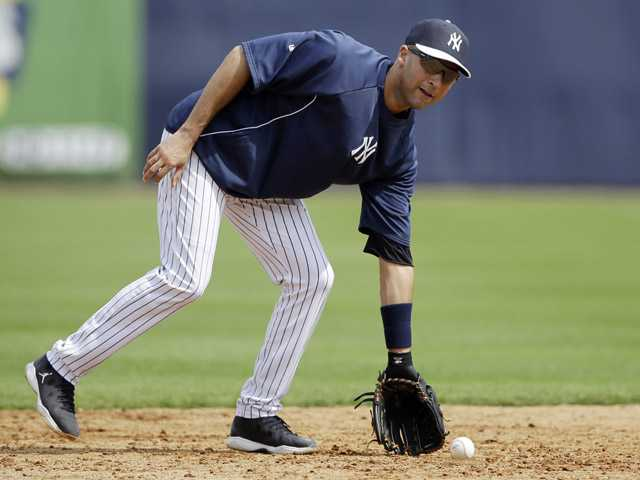 New York Yankees' Derek Jeter fields a grounder during a workout at baseball spring training, Wednesday. (AP)
