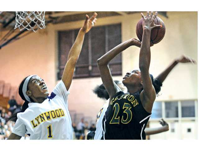 Canyon High's Alia McCoy (23) shoots against Lynwood High defender Jazmine Johnson (1) at Lynwood on Saturday in their CIF-Southern Section Division IIAA quarterfinal.