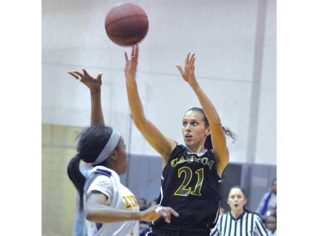 Canyon's Jaya Schultz (21) shoot a three pointer at the final buzzer against Lynwood High School in Lynwood on Saturday.