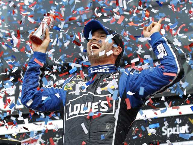 Jimmie Johnson celebrates after winning the Daytona 500 race on Sunday in Daytona Beach, Fla.