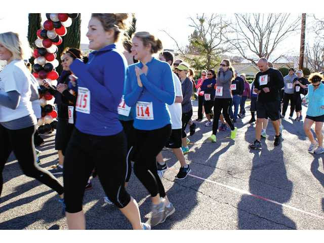 More than 200 runners participated in the WiSH Education Foundation Run For Gold races in Newhall on Sunday.