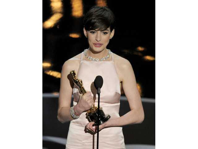 "Anne Hathaway accepts the award for best actress in a supporting role for ""Les Miserables."""