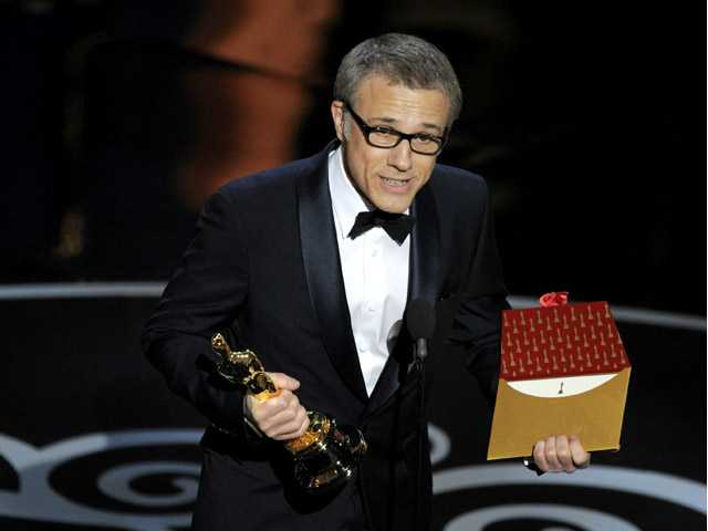 "Actor Christoph Waltz accepts the award for best actor in a supporting role for ""Django Unchained"" during the Oscars."