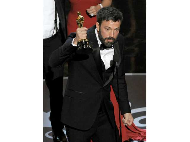 "Ben Affleck accepts the award for best picture for ""Argo"" during the Oscars."