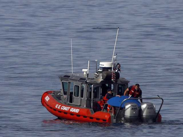 Crews searched by sea and air to find a husband and wife and two young children who sent a series of distress calls to the Coast Guard. Above, a crew rescues a Salinas man on Saturday.