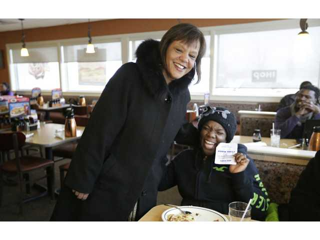Former Illinois state Rep. Robin Kelly, a Democrat, finds a supporter in Yolanda Stratton as she campaigns at an IHOP.