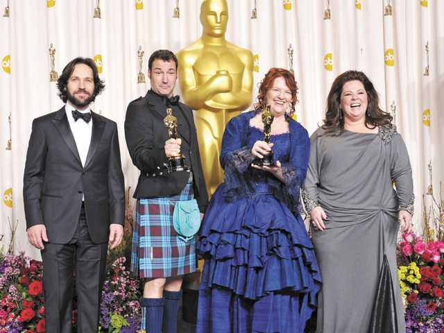 "Presenter Paul Rudd, from left, director Mark Andrews, Brenda Chapman, and Melissa McCarthy pose with their award for best animated feature film for ""Brave"" at the Oscars at the Dolby Theatre on Sunday, in Los Angeles."