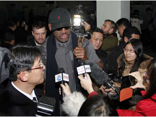 Flamboyant former NBA star Dennis Rodman is surrounded by journalists upon arrival at Pyongyang Airport, North Korea.