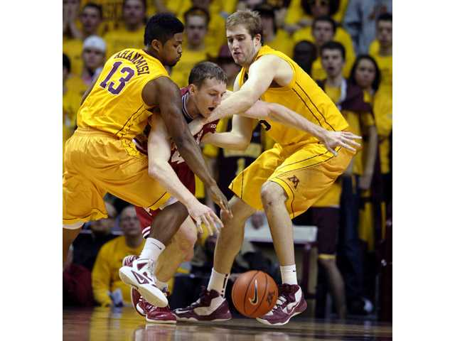Indiana's Cody Zeller, center, attempts to break free of the trap put on by Golden Valley High graduate and Minnesota guard Maverick Ahanmisi (13) and Elliot Eliason on Tuesday in Minneapolis.