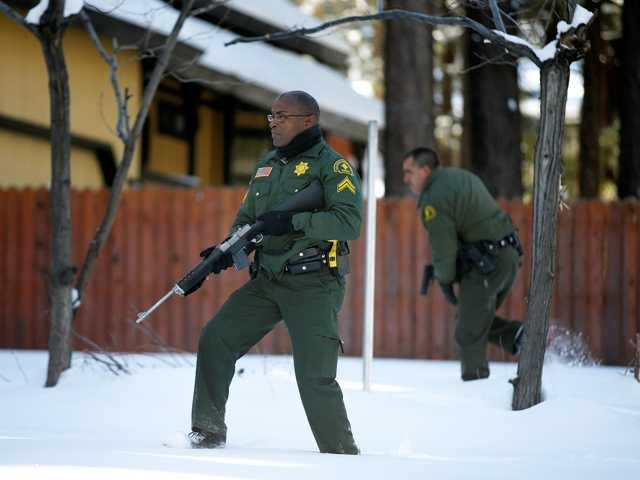 Sheriff's officers search a Big Bear home for former LAPD police officer Christopher Dorner Feb. 10. Six former officers have requested a reopening of their termination cases.