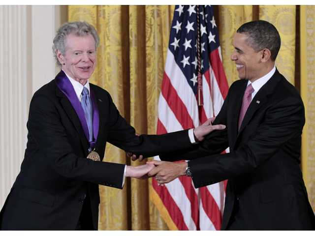 This March 2, 2011 file photo shows President Barack Obama presenting a 2010 National Medal of Arts to pianist Van Cliburn.