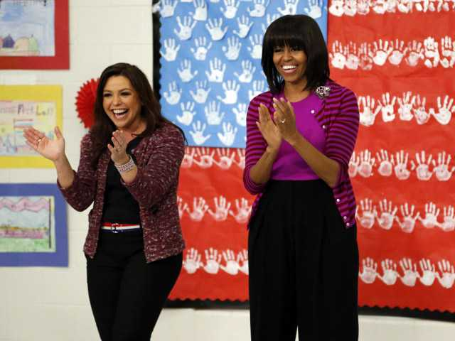 "First lady Michelle Obama and Food Network chef Rachel Ray greet elementary school students at a ""Let's Move!"" program in Clinton, Miss."