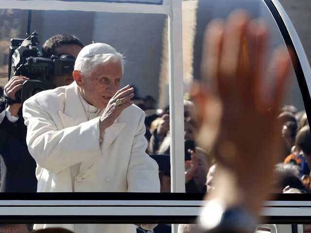Pope Benedict XVI greets pilgrims in St. Peter's Square at the Vatican, Wednesday.