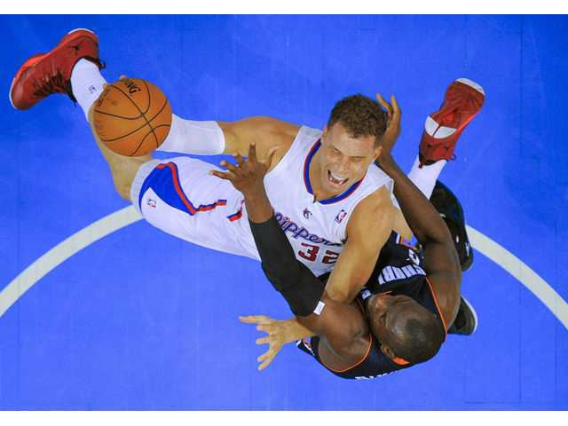 Los Angeles Clippers forward Blake Griffin, top, drives to the basket over Charlotte Bobcats forward Bismack Biyombo in Los Angeles on Tuesday.