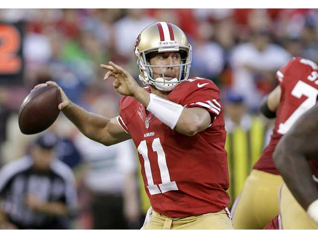 In this Oct. 18, 2012 photo, San Francisco 49ers quarterback Alex Smith (11) passes against the Seattle Seahawks during the second quarter of an NFL football game in San Francisco. A person with knowledge of the trade tells The Associated Press that the Kansas City Chiefs have agreed to acquire Smith from San Francisco.