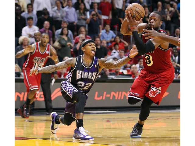 Miami Heat's Dwyane Wade (3) drives against Sacramento King Isaiah Thomas on Tuesday in Miami.
