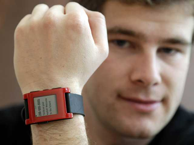 Eric Migicovsky, CEO of Pebble, displays his company's smart watch in Palo Alto, Calif.