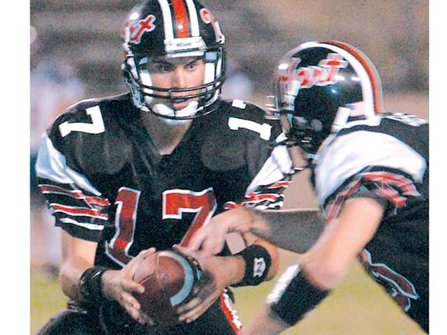 Matt Moore (17) hands the ball off during a 2002 Hart High football game. Moore, now an NFL quarterback, is collaborating on a blood drive Saturday at Whole Foods.