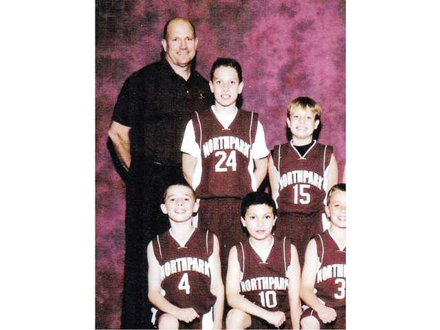 Brooks (15) and Klehn (4) pose with their elementary school teammates as a third and fourth grader, respectively.