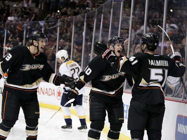 Anaheim Ducks right wing Kyle Palmieri, right, celebrates his hat trick with Nick Boninoright, left, and Corey Perry during the second period.