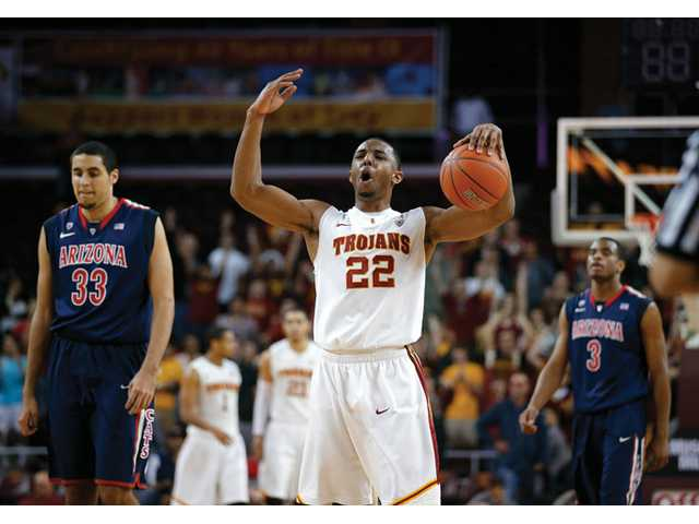 USC's Byron Wesley, center, reacts to a foul call on Arizona during the second half in Los Angeles on Wednesday.