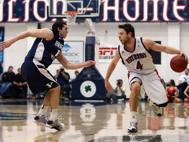 Saint Mary's Gaels guard Matthew Dellavedova (4) tries to get around Brigham Young Cougars guard Matt Carlino in the first half of the NCAA basketball game. (AP)