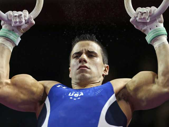 Jacob Dalton, of the United States, performs on the rings during the American Cup gymnastics competition in Worcester, Mass.