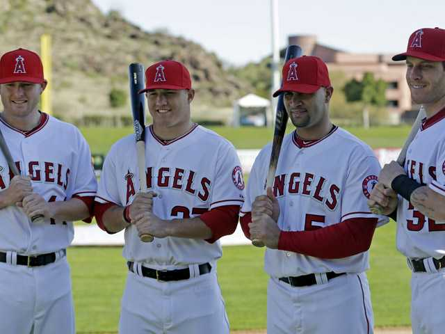 Los Angeles Angels' Mark Trumbo, left to right, Mike Trout, Albert Pujols and Josh Hamilton pose for photographers during photo day before a spring training baseball workout Thursday, Feb. 21. (AP)