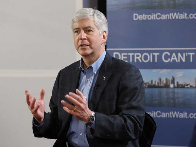 Gov. Rick Snyder declares a financial emergency during a broadcast in Detroit, Friday. (AP)
