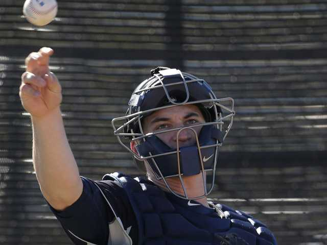 Seattle Mariners catcher Mike Zunino throws a ball during a spring training baseball workout. (AP)