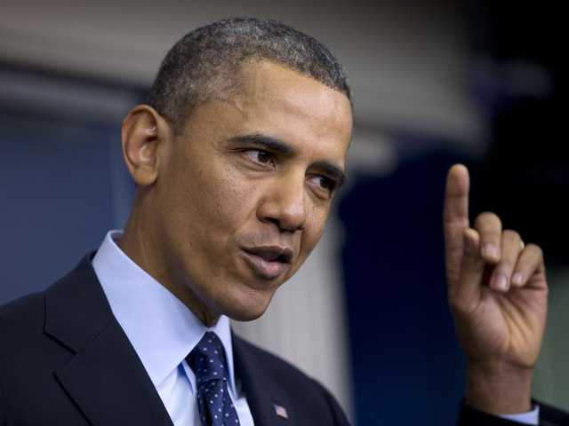 President Barack Obama gestures as he speaks to reporters in the White House briefing room in Washington, Friday. (AP)