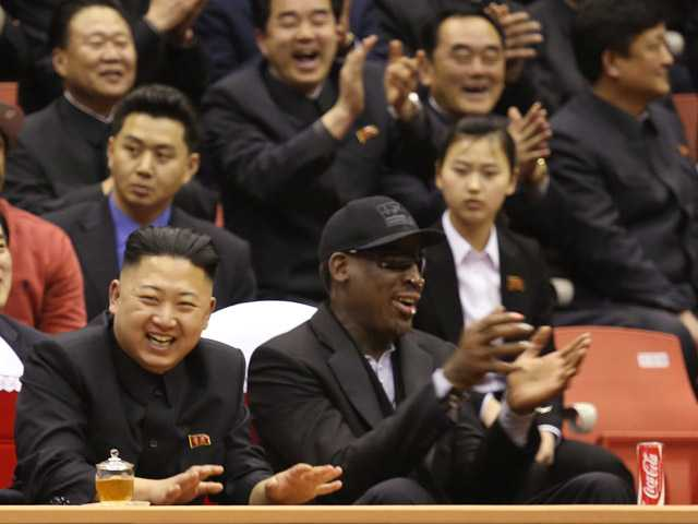 North Korean leader Kim Jong Un and former NBA star Dennis Rodman watch North Korean and U.S. players in an exhibition basketball game at an arena in Pyongyang, North Korea. (AP)