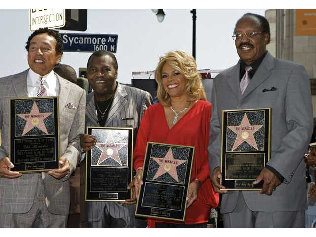 "The Miracles, from left: William ""Smokey"" Robinson, Warren ""Pete"" Moore, Claudette Robinson, and Robert ""Bobby"" Rogers."