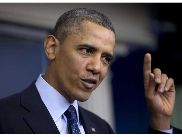 President Barack Obama gestures as he speaks to reporters in the White House briefing room in Washington, Friday.