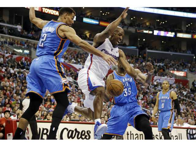 Los Angeles Clippers guard Chauncey Billups (1) loses the ball as Oklahoma City Thunder forward Thabo Sefolosha (2) and forward Kevin Durant (35) defend on Sunday in Los Angeles.