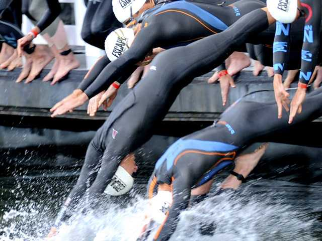 Competitors dive into the San Francisco Bay at the start of the Escape From Alcatraz triathlon, Sunday, June 5, 2011. (AP)
