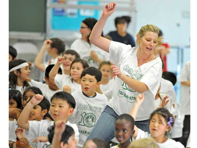 "Second-grade teacher Shali Borkowski joins students in dancing to ""Gangnam Style"" at a ""Dance It Out"" class at Pico Canyon Elementary School in Stevenson Ranch on Friday."