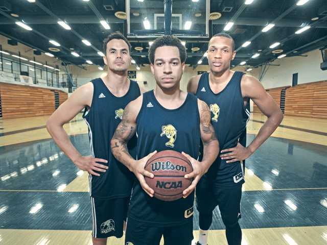 College of the Canyons basketball players, from left, freshman guard David Horst, 25, sophomore guard Terrez Scott, 22 and sophomore forward Ron Harris, 24.