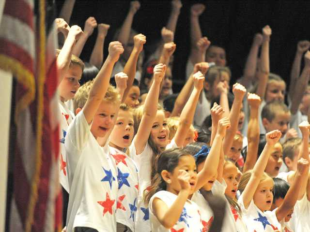 "Students cheer as they perform Neil Diamond's ""America"" as ""First Grade Salutes America"" at Pico Canyon Elementary School in Stevenson Ranch on Thursday. (Jonathan Pobre/The Signal)"