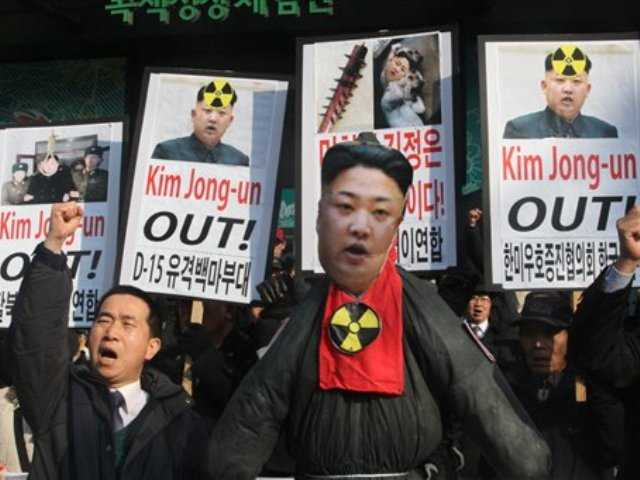 South Korean protesters shouts slogans near an effigy of North Korean leader Kim Jong Un during an anti-North Korea rally to denounce North Korea's nuclear test in Seoul, South Korea, a day after North Korea defied U.N. warnings with a nuclear test.