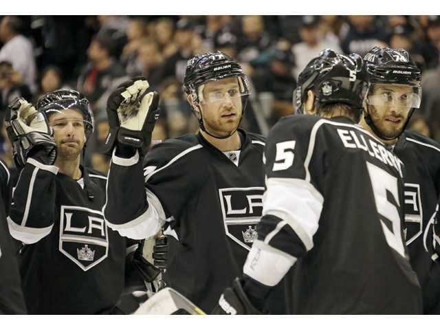 Los Angeles Kings center Jeff Carter, middle, is congratulated by teammates after the team beat the Nashville Predators on Monday in Los Angeles.