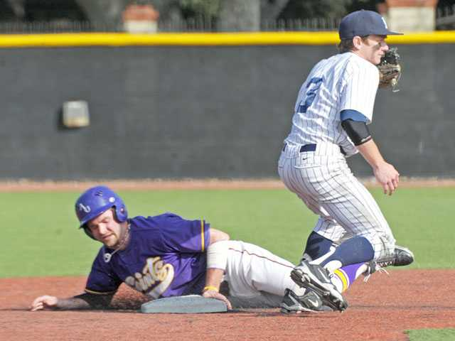 Ashford University's Michael Bruns is caught stealing at second base by The Master's College's Sam Robison in the third inning on Tuesday at Reese Field.