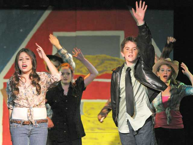 "Alyssa Farris as Ariel Moore, left, and Ethan Ross as Ren McCormack join the cast in performing the opening musical number in ""Footloose"" at Arroyo Seco Junior High School in Saugus on Wednesday night. Performances continue at the junior high on Thursday and Friday at 7 p.m."