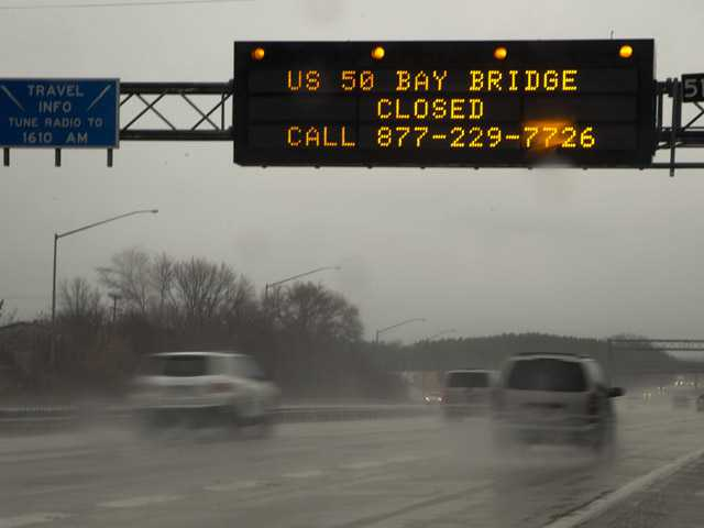 A sign spanning Interstate 97 South in Millersville, Md., on Wednesday, alerts travelers that the Chesapeake Bay Bridge is closed in both directions because of high winds, according to he Maryland Transportation Authority.