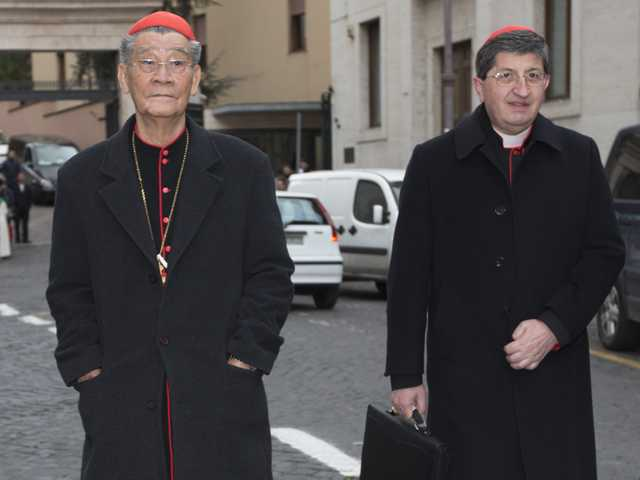 Vietnamese Cardinal Jean-Baptiste Pham Minh Man, left, and cardinal Giuseppe Betori arrive for a meeting, at the Vatican, on Thursday. (AP)