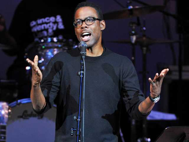 "Actor Chris Rock performs at ""The Music of Prince"" tribute concert at Carnegie Hall on Thursday New York. (AP)"