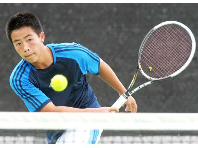 West Ranch singles player Christopher Gaw returns a shot against Campbell Hall on Thursday at West Ranch High.