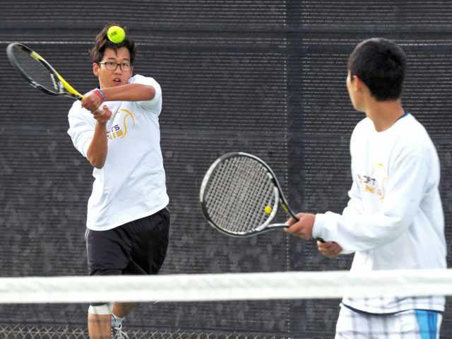 West Ranch doubles teammates Jonathan Lee, left, and Brandon Oh compete against Campbell Hall on Thursday at West Ranch High School.