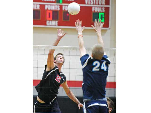 Hart's Tanner Tengberg tips the ball over a Crescenta Valley's player on Thursday at Hart High School.
