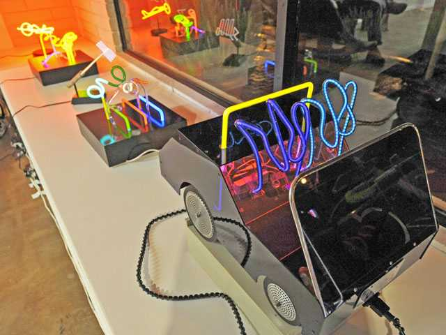Neon art pieces by Linda Sue Price and Michael Flechtner on display in the J. Serraino shop on Main Street during the Art Slam in Newhall on Thursday. Signal photo by Jonathan Pobre